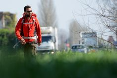 """ITALY, Modena : French rogue trader Jerome Kerviel walks on a road to leave Modena on March 19, 2014, during his trek from Rome to Paris """"against the tyranny of the markets"""".  AFP PHOTO / GABRIEL BOUYS"""