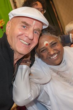 I AM immersed in a sea of divine love with a living saint, Amma. There are no words to describe the inner glow I felt as I was held, hugged and loved by this celestial being who walks among us. I sat next to her for over an hour observing her embracing hundreds of people, and I will forever feel the inner glow. ~ Dr. Wayne Dyer ~