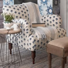 """Floral Indigo Arm Chair The soft curves and wood spindle legs of this arm chair is covered in a charming Indigo Blue flowered pattern. 100% cotton. Made in the USA. (33""""Hx32""""Wx30""""D) Seat 19"""""""
