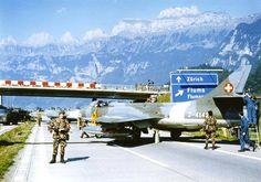 During the height of the Cold War, Switzerland prepared itself for war returning to Europe. Here, Swiss Hawker Hunters are being prepped for take-off on the highway near Flums, in exercises creating improvised runways from stretches of. Luftwaffe, Plane Photos, Swiss Air, Old Planes, Aircraft Design, Cold War, Military History, Armed Forces, Military Aircraft