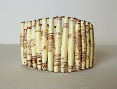 Awesome Statement Bracelet with brown and beige paper beads. This handmade by rolling pieces of paper to a bead, varnishing & stringing by this artist on etsy....PaperStatement...has many other great pieces