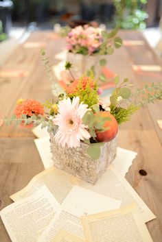 Table Decor: Butcher paper, wild flowers in vases, and old book pages for runner.  Does dad have any bark like things we can do this with?