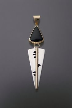 Onyx pendant set in 14kt gold and silver by GldnRamMtlsmithing, $198.00