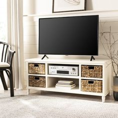 Rooney Entertainment Unit in Distressed White - Safavieh ideal TV unit for coastal and country interiors, this pine piece in distressed white finish has natural rattan baskets with cutout handles to make finding all entertainment essentials a Bedroom Tv Stand, Tv In Bedroom, Bedroom Hacks, Bedroom Ideas, Tv Stand Set, Small Tv Stand, Tv Stand With Storage, Tv Stand With Shelves, Tv Stand Ideas For Small Living Room
