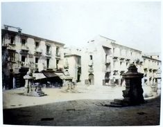 Piazza Santa Maria La Porta, incrocio tra Torrente Boccetta e Corso Cavour: le Fontane dei Quattro Cavallucci in una fotografia di Eugène Sevaistre del 1858