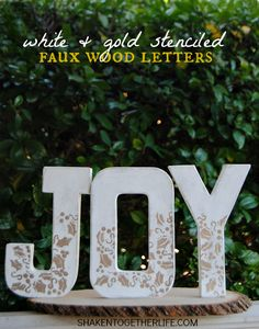DIY Craft store paper mache letters get a white and gold stenciled makeover to look like faux wood letters! - Royal Design Studio Christmas stencils - via Shaken Together Life