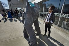 """""""Dressed as """"Leatherback"""" from the movie 'Pacific Rim' Andrea Hveem 18 of San Francisco, center, walks with friend Chris Birr 18 of San Francisco during the Sac Anime Convention at the Sacramento Convention Center in Sacramento on Saturday, January 4, 2014."""""""