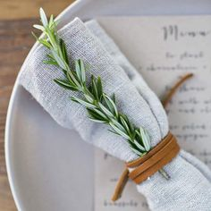 Add a sprig of rosemary to your Thanksgiving place setting for a simple but elegant detail.  XXJKE