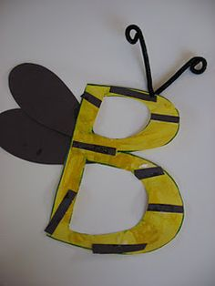We did a big 'B' like this but with waxed paper wings and then a little 'b' with yellow marble painting on black.