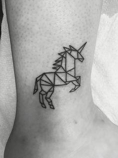Geometric unicorn tattoo done by Aron Matthews at 7th street tattoo and body piercing