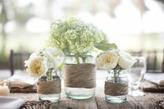 rustic wedding centerpieces ideas: Decorate your mason jars with bakers twine and add gorgeous flowers to finish the look. Easy to do and great rustic wedding decorations Mason Jar Centerpieces, Rustic Wedding Centerpieces, Wedding Table, Diy Wedding, Mason Jars, Wedding Flowers, Wedding Decorations, Table Decorations, Centerpiece Ideas