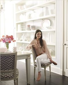 Love this wall of cabinets with all white on white displayed, Also the beautiful table!!!