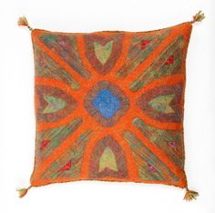 The pattern on the cushion evokes a Baroque garden. Through the maze of closely-trimmed shrubs we arrive at a pond where gold fish are frolicking.  A cushion is made with wet felting technique with a piece of spun and embroidered rope around it.