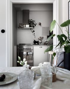Small home, great style - via Coco Lapine Design Kitchen, ideas, diy, house, indoor, organization, home, design, cook, shelving, backsplash, oven, desk, decorating, bar, storage, table, interior, modern, life hack.