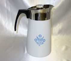 This is a vintage Corning Ware 10 cup stove top coffee pot.  The coffee pot is in the cornflower blue pattern and is in excellent condition.  It is