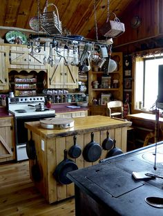 Rustic country kitchen. love all the cast iron!!