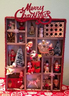 I love to collect old Christmas trinkets.  After seeing some other Christmas shadow boxes here on Pinterest I found the perfect way to display them :)