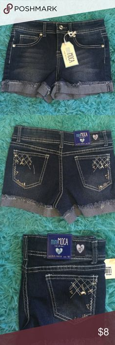 🎉GIRLS MINI MOCA DARK WASH SHORTS NWTO🎉🎉🎉🎉 🎉🎉MINI MOCHA GIRLS DARK WASH DENIM SHORTS. Super cute for that little fashionista in your life. Distressed cuff with Blinged back  pockets. Brand new. Only took out of shipping package to photograph. Great shorts for that young lady that is already hitting her stride in being the most fashionable gal on the block. Super cute. Brand new. Great time to grab these for your sweet little fashion forward gal🎉🎉🎉🎉🎉🎉🎉🎉🎉🎉🎉🎉🎉🎉 Mini Moco…