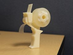 """A mini tape gun for the Christmas elf in all of us. Print one of these and get to wrapping presents. This is a 3d printable version of a mini tape gun I had laying around. It holds the standard tape dispenser rolls. You know, the little 3/4"""" rolls that you use to wrap presents with at Christmas time. It prints in 4 parts with support and the little side piece that holds the roller on it simply pressed into place as the layer ridges seem to hold it in. But if that doesn't hold, a bit of…"""