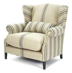 This one would tie the beige furniture and the blue accents together  Napoleon French Fog Linen Blue Stripe Wingback Arm Chair