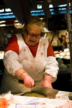 Fish monger, La Boqueria Market, Barcelona, Spain.  Photo: Ruben Vincente