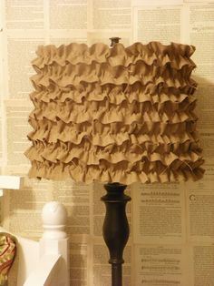 Ruffle it up! Sewn fabric strips are hot glued to cover an old, but sturdy shade.