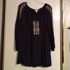 Navy blue blouse Love this dark navy blue blouse with lovely embroidery.  I'm a 10-12 and it fits me well. Dress Barn Tops Blouses