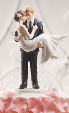 """Romantic cake topper. We didn't choose this, but the forehead-press is our """"thing""""."""