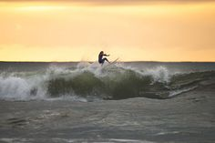 ASP World Tour surfer Paige Hareb surfing at sunset in Taranaki, New Zealand