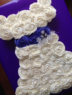 Bridal Shower - Bridal shower cake made out of cupcakes in the shape of a wedding dress.  French vanilla and lemon cupcakes with vanilla buttercream frosting.