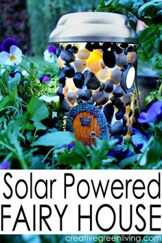 How to make a solar powered fairy house with a recycled bottle and dollar store supplies. This is SO COOL - perfect centerpiece for a fairy garden.