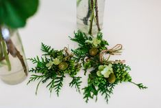 Green buttonholes with pine cones - Image by Therese Winberg Photography - A forest green wedding colour scheme at an intimate outdoor coastal ceremony in Finland with DIY wedding dress, flowers and stationery