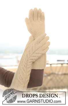 "Long knitted DROPS gloves in ""Nepal"" with cables. ~ DROPS Design"