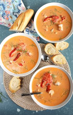 Overhead shot of three white bowls filled with lobster bisque with lobster claws in the center of each bowl and a broken baguette on the side. Lobster Recipes, Seafood Recipes, Gourmet Recipes, Soup Recipes, Cooking Recipes, Cooking Tips, Fennel Recipes, Oven Cooking, Cooking Food