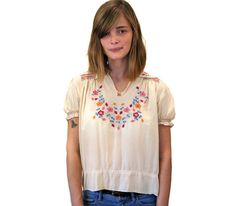 This is a lovely authentic 1920s bohemian embroidered silk peasant blouse. It is creamy ecru silk crepe with hand stitched pink, gold and blue