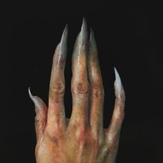 the ends of his fingers form into boney little claws.
