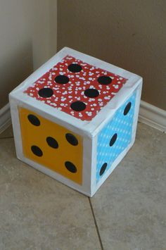 Made this big dice on a rainy day for my 3 year old. We have found many different ways to use it. For example, if he rolls a 6, then he has to hop one foot 6 times. It is also has a different color on each side, so if he rolls a blue, he has to find something blue in the house. Way Fun! Just get a cardboard box, paper and start taping away.