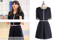 Jess Day (Zooey Deschanel) wears this navy dress with taupe-grey accents in this week's episode of New Girl.