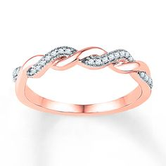 Two ribbons - one lined with diamonds and one of 10K rose gold - twist together along the top of this gorgeous ring for her. The ring has a total diamond weight of 1/10 carat. Diamond Total Carat Weight may range from .085 - .11 carats.