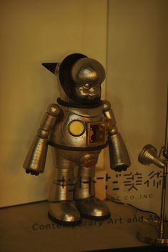 A little robot statue snapped in the window of a high class art gallery in Tokyo's Ginza district.