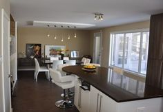 Our clients loved their north Winnipeg home – but the kitchen needed an overhaul. Learn how home renovation team made the homeowners fall in love again Kitchen Renovations, Home Renovation, Forest Park, Kitchen Design, Construction, Table, Furniture, Home Decor, Building