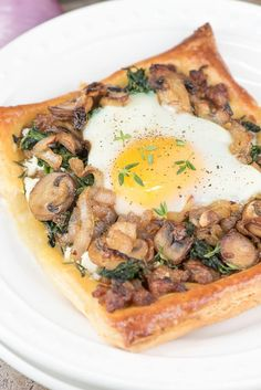 This savory Sausage, Mushroom & Egg Galette is rich, creamy and decadent - perfect for any occasion, and makes an elegant plate.