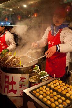 Street vendor selling dumplings at Hong Kong's Night Market. #market #food