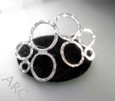 Organic design stud earrings £24.00