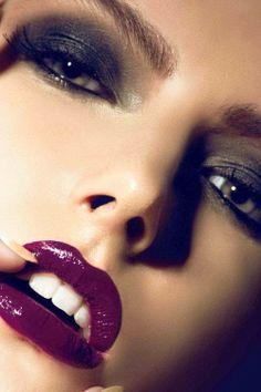 Deep purple glossy lips and smokey eye