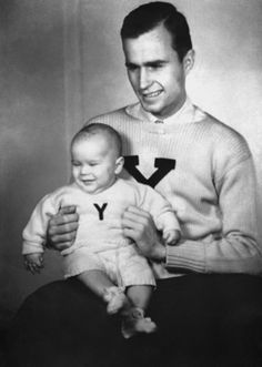 George H.W. Bush and George W. Bush sporting Yale sweaters