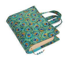 Padded Book Cover Bag in a beautiful Timeless Treasures design of peacock feathers in turquoise, jade, royal blue and with gold highlights. Features 3 semi-precious turquoise beads on the bookmark. Fabric Book Covers, Valentines Presents, Popular Crafts, Bible Covers, Notebook Covers, Peacock Feathers, Sewing Patterns, Sewing Ideas, Sewing Projects