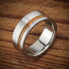 Mens wood wedding band in titanium by Spexton.