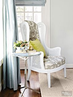 Fresh white paint enhanced the cane panels and the chair's wood frame. Gray-and-white ikat fabric replaced gold velour. When picking fabric for an upholstery project, pay attention to scale. Because this chair is tall, it easily handles a larger scale print.