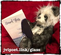 """Light shines through the tinted glass so beautifully in these poems,"" exclaimed Ainsley.  #poetry #bookstagram #poetrybook #abearandabook #charliebear"